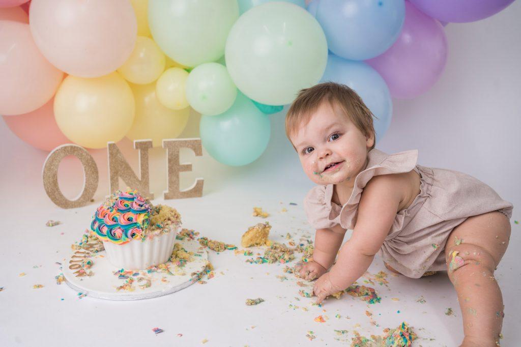 Little baby crawling and mushing cake