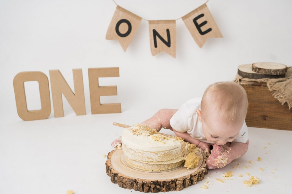 Little baby smashing a cake and eating it