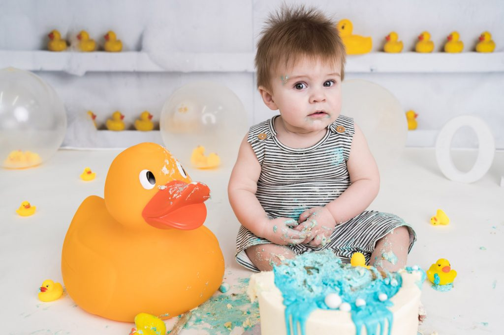 Large yellow rubber duck and baby