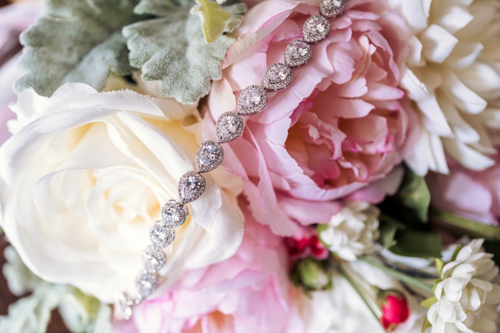 necklace and flowers wedding photography