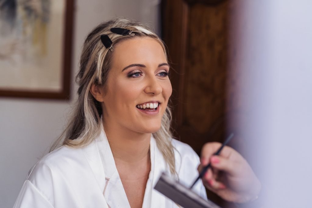 Bride getting ready with makeup