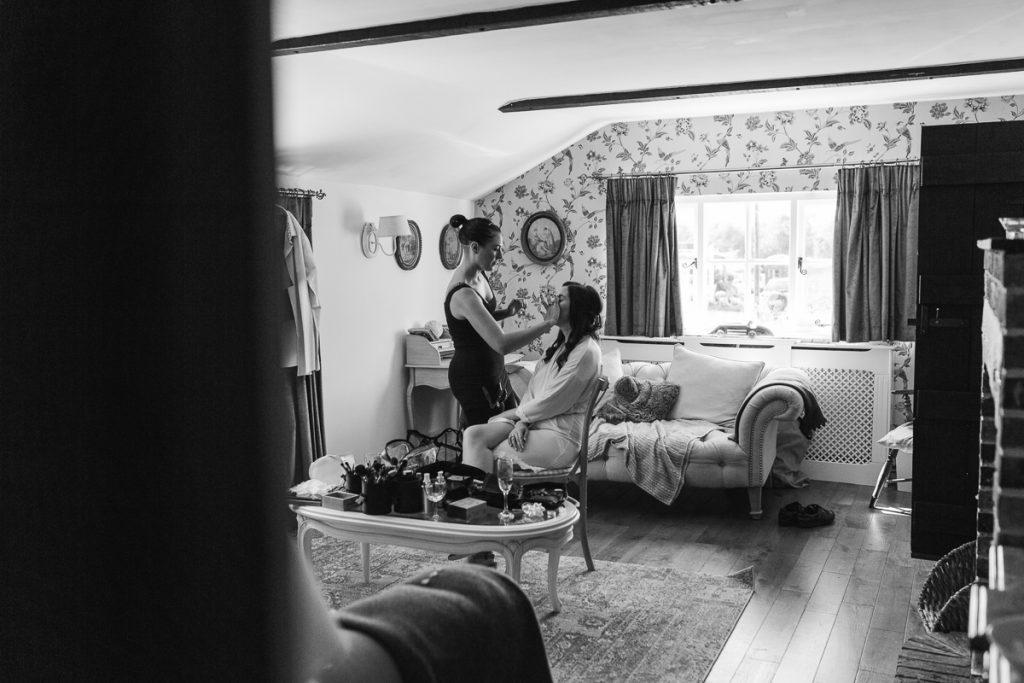 black and white photo of bride getting ready for her wedding