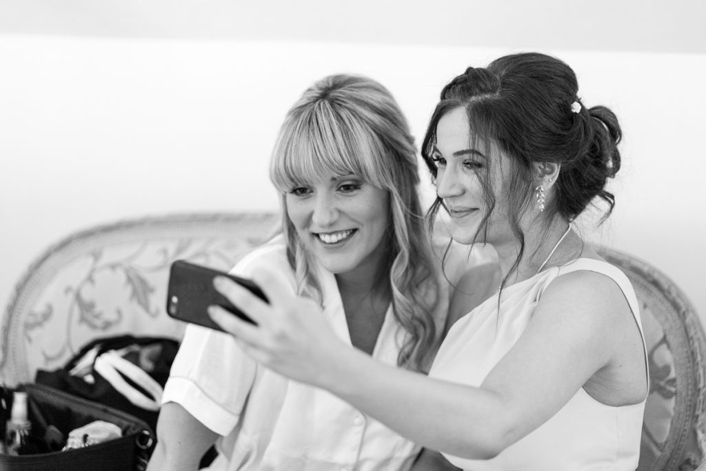 selfie moment of bride with bridesmaid