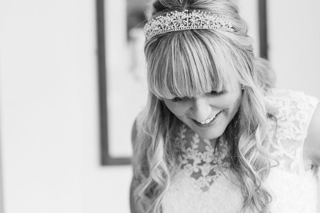 black and white photo of bride wearing her tiarra