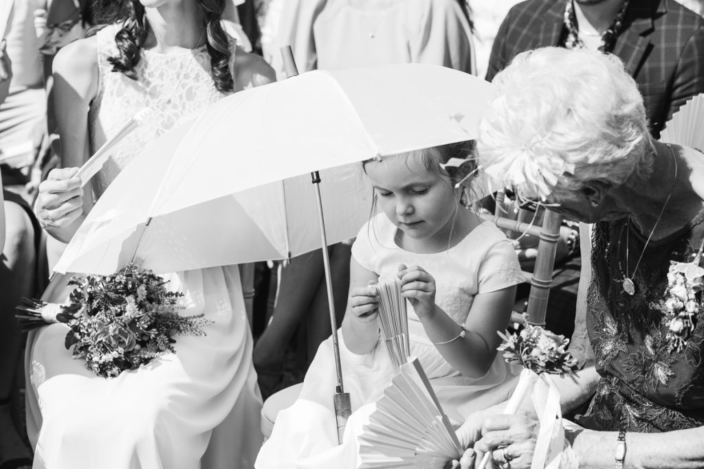 black and white photo of girl with umbrella