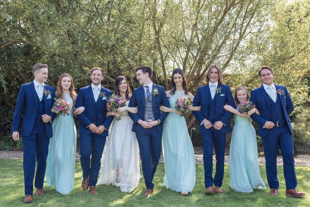 bridesmaid and grooms and bride and groom
