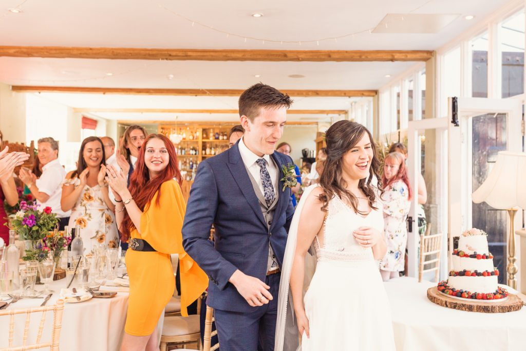 bride and groom and wedding guests