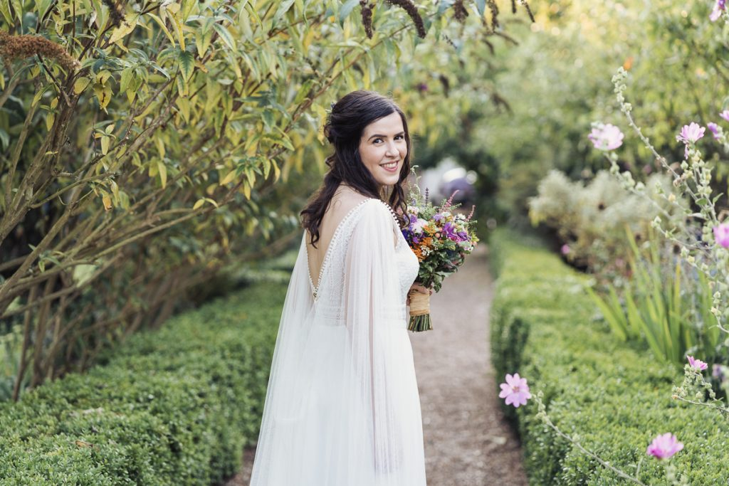 beautiful bride on path outdoors
