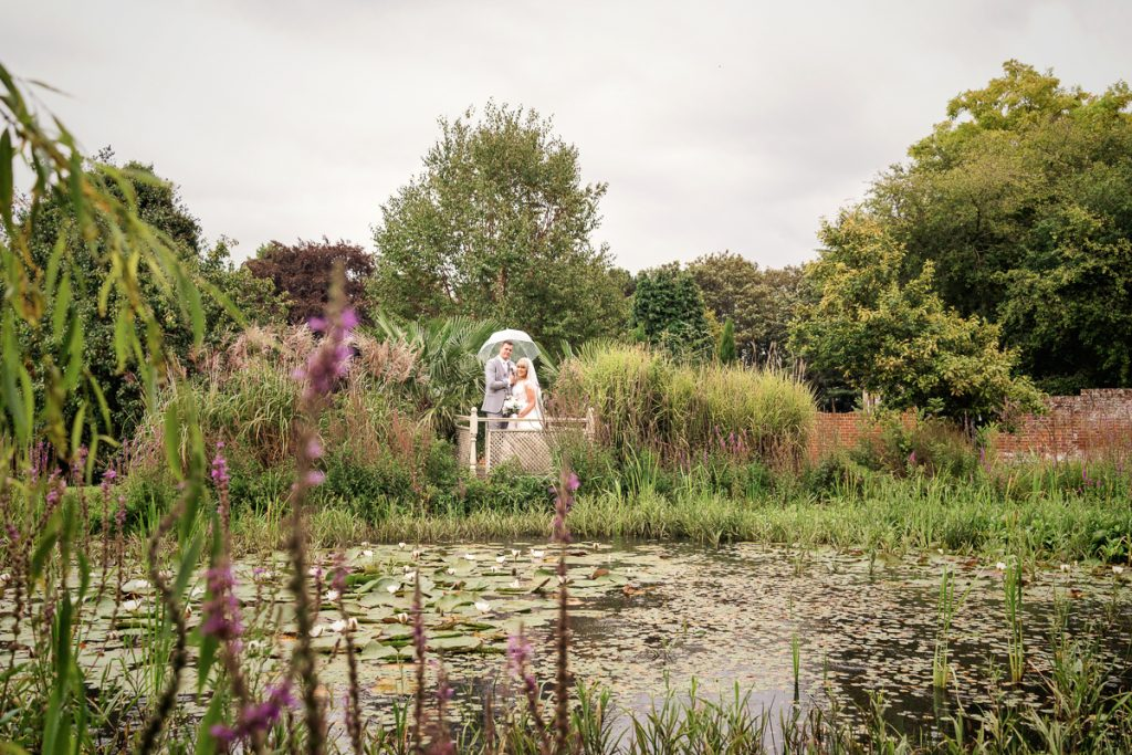 by the pond distant wedding photography photo