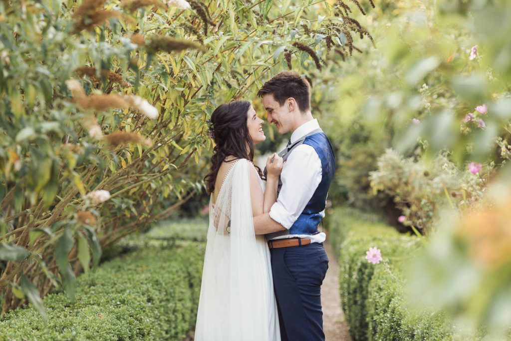 bride and groom in an outdoor setting with trees