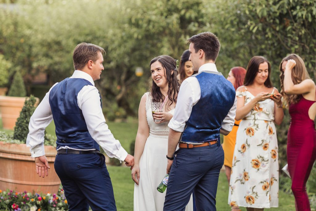 bride and groom enjoying time with their guests