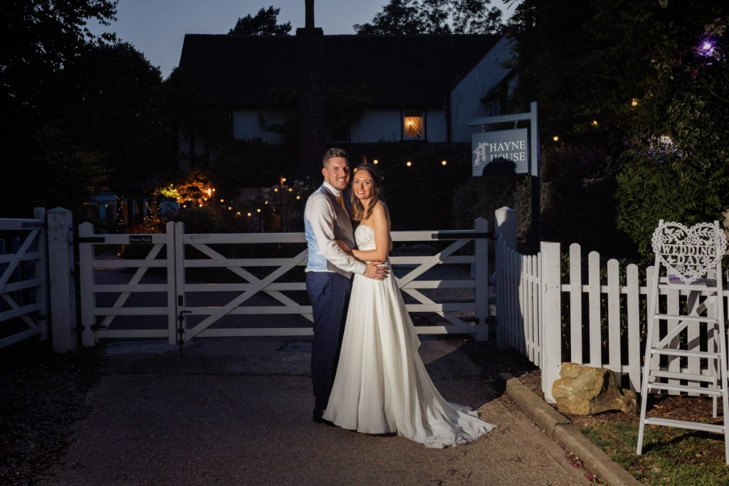 Bride and Groom stood outside the front entrance of Hayne House