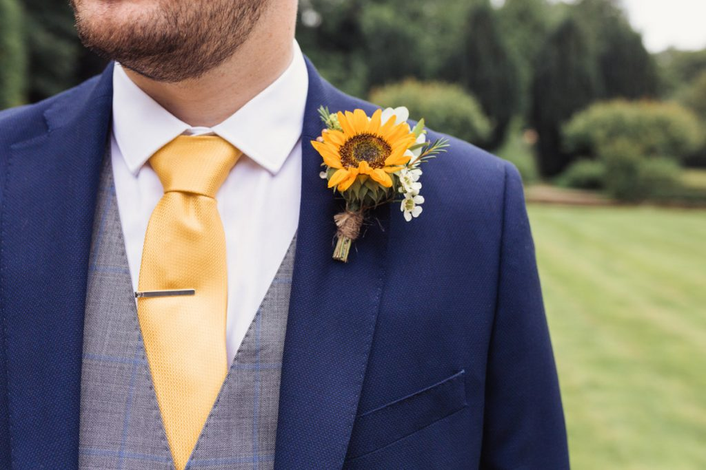 close up of the groom's boutonniere