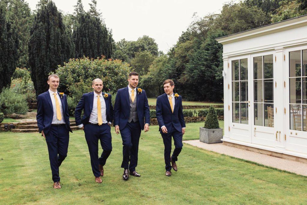 the groomsmen walking alongside the groom