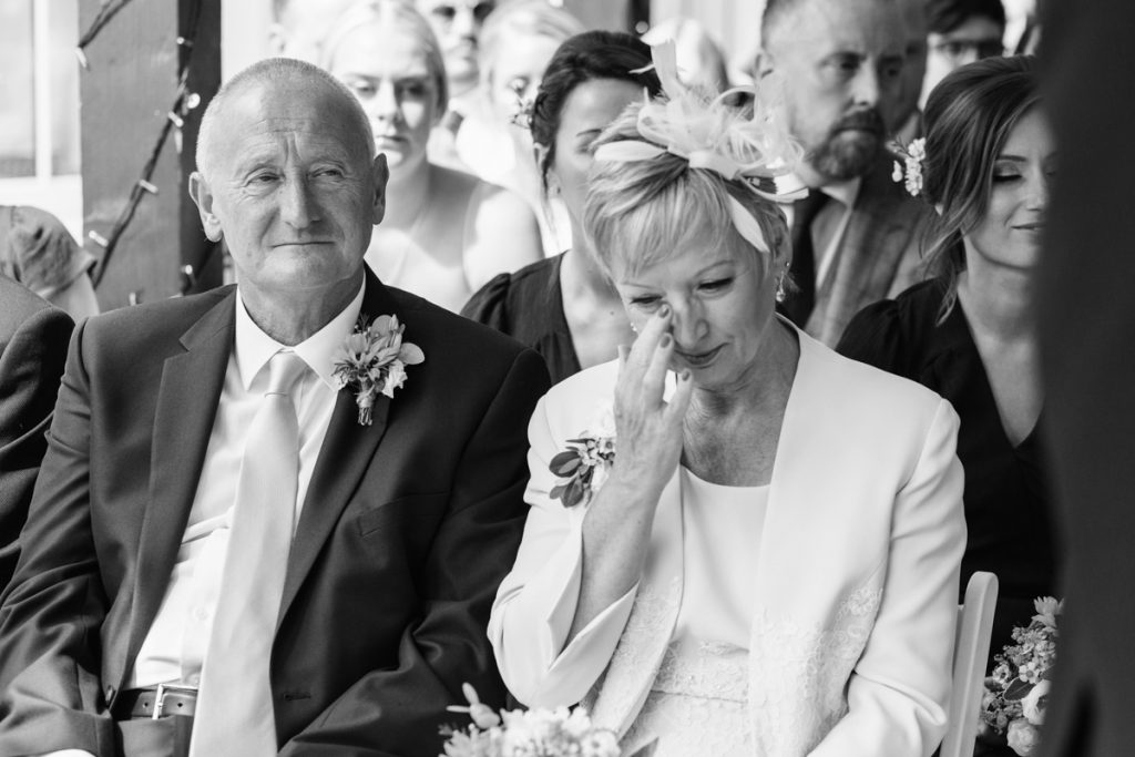 happy tears from mother and father in law on a wedding day