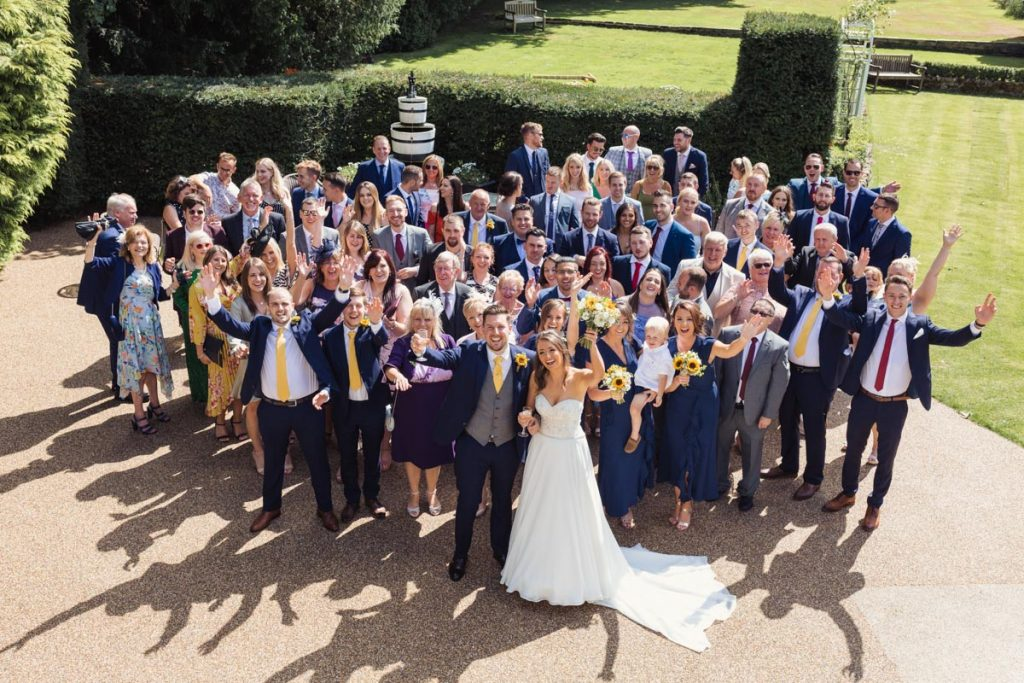 a birds eye view of the wedding guests with bride and groom