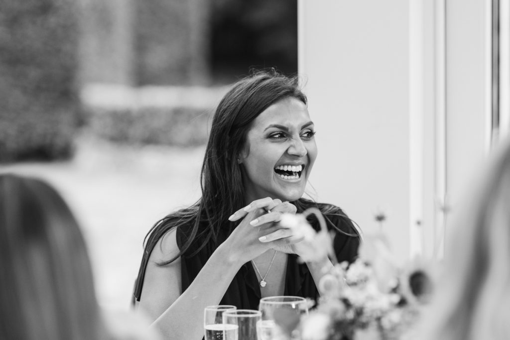 elated and laughing guest at a Kent wedding
