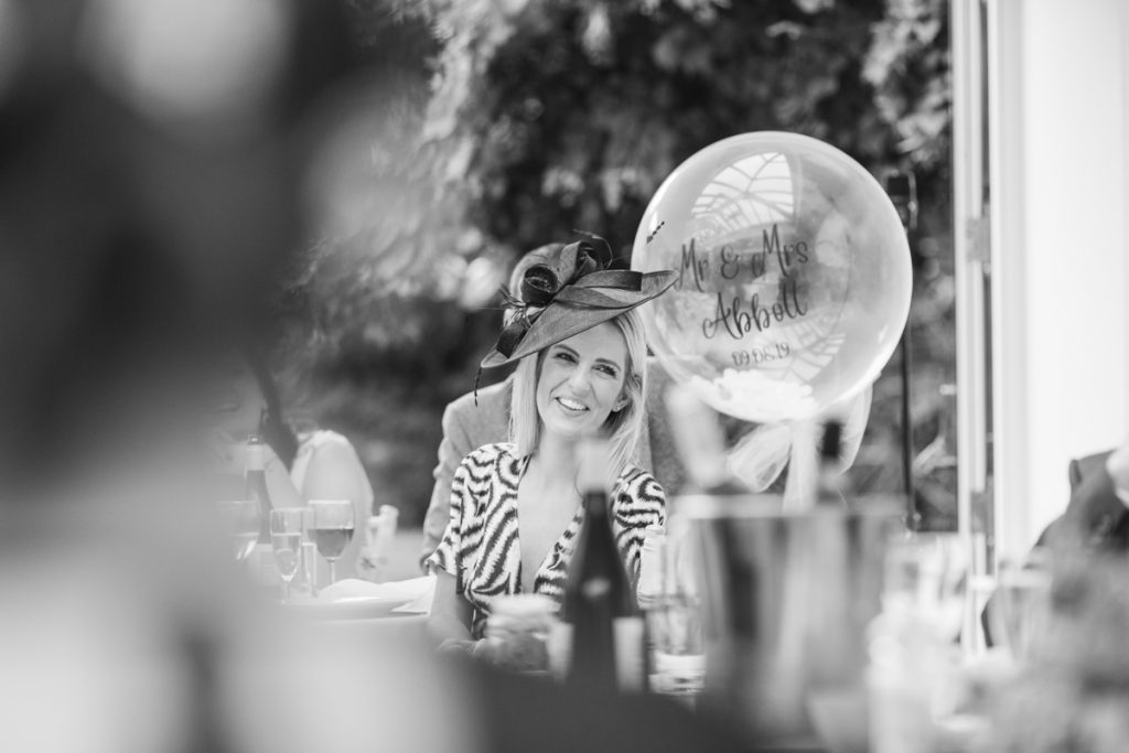 A lovely wedding hat worn by a guest