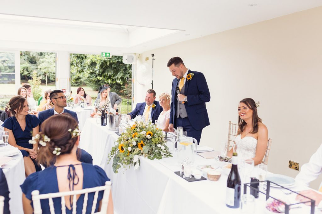 the groom does his speech on his wedding day in Kent