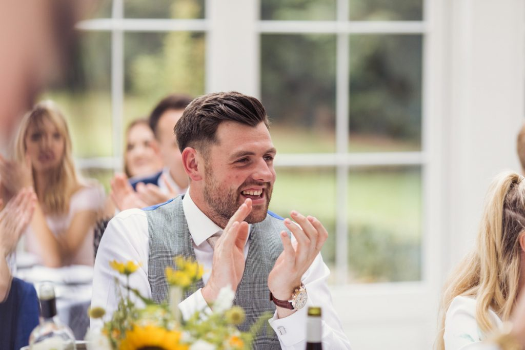 guest at a wedding clapping his hands