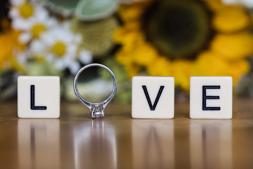 Love spelt with wedding ring and scrabble tiles