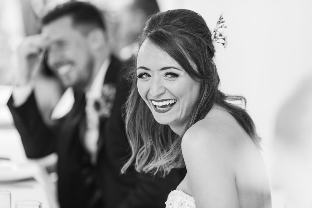black and white bride laughing