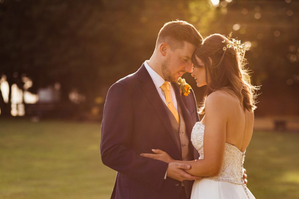 intimate moment between bride and groom outdoors