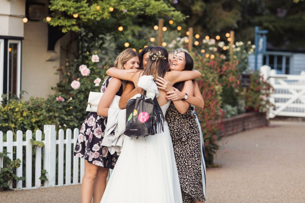 group hug with the bride and her close family and friends