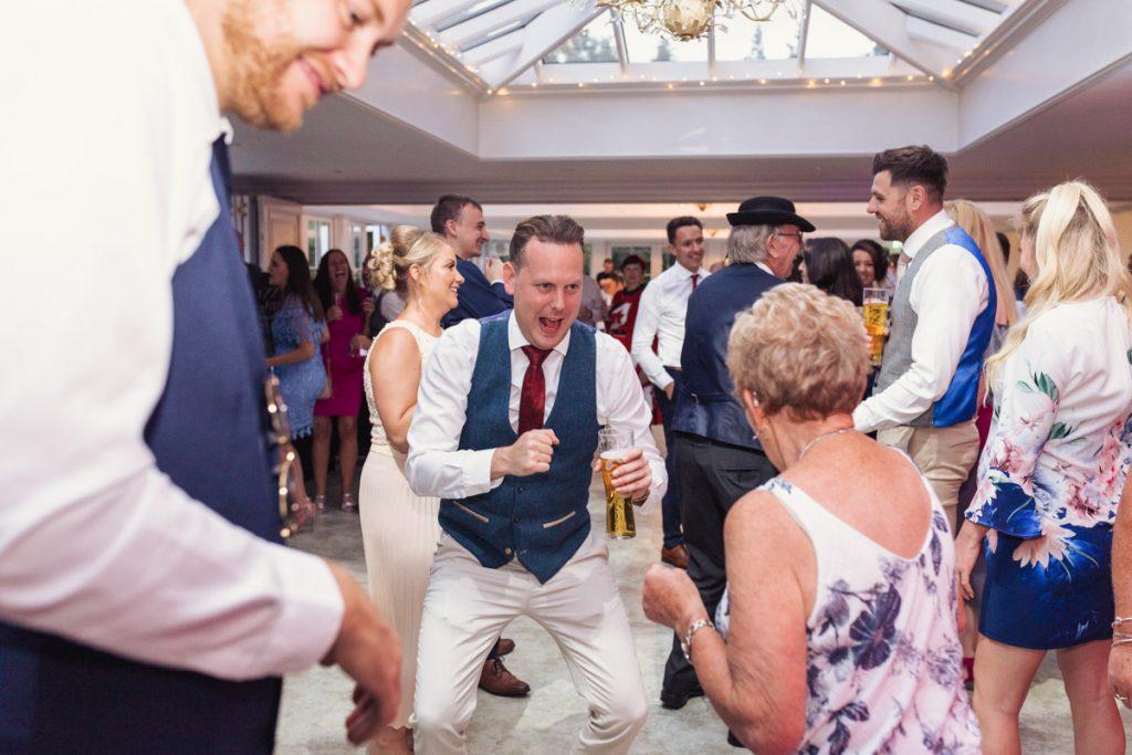 dancing at a wedding indoors