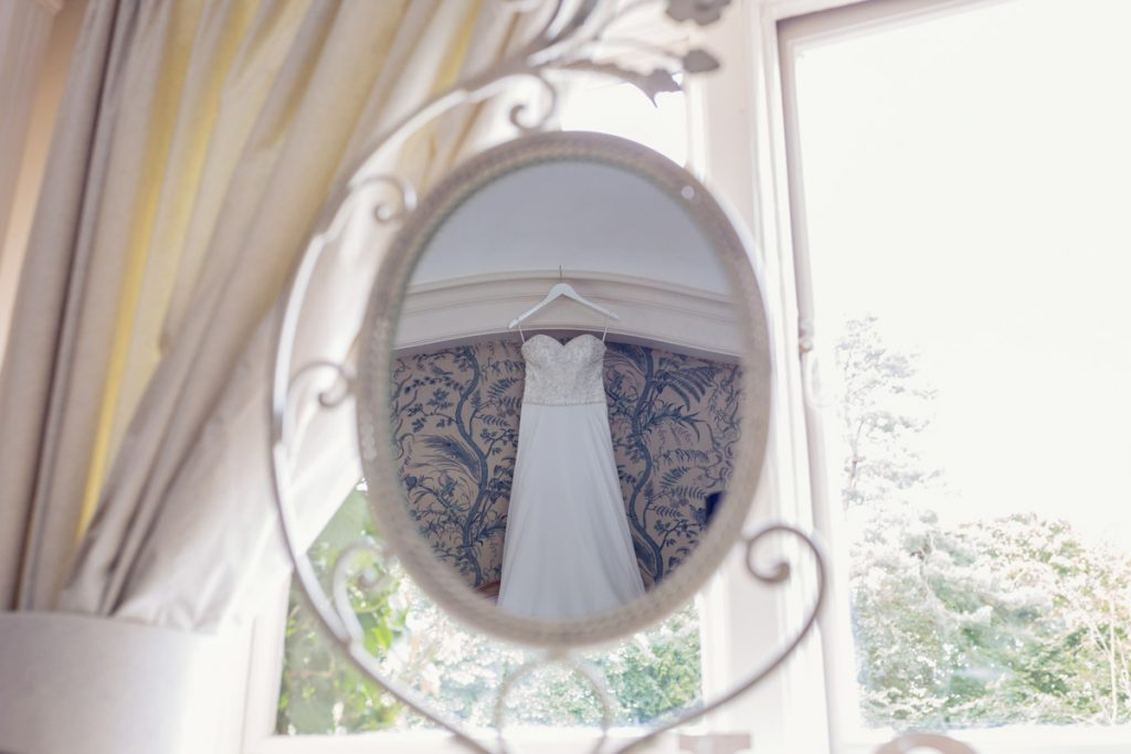 Wedding dress in a reflection of a chic mirror in Kent