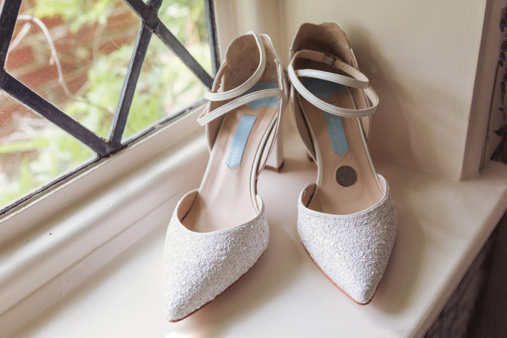 wedding shoes sat on a window sill in Kent