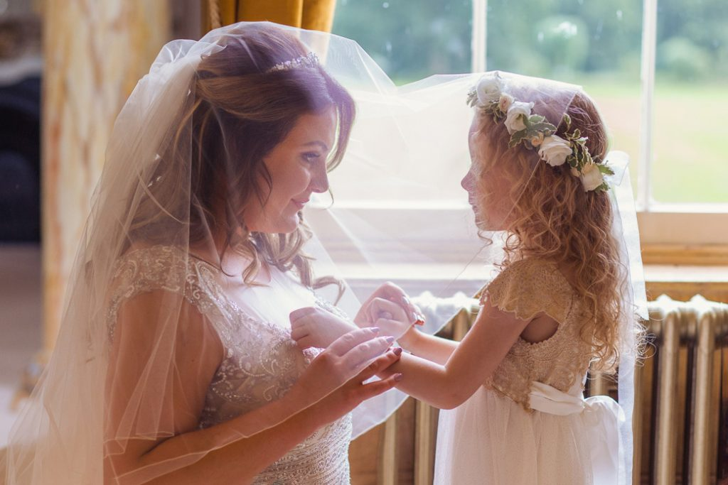 Mother and daughter preparing to walk down the aisle