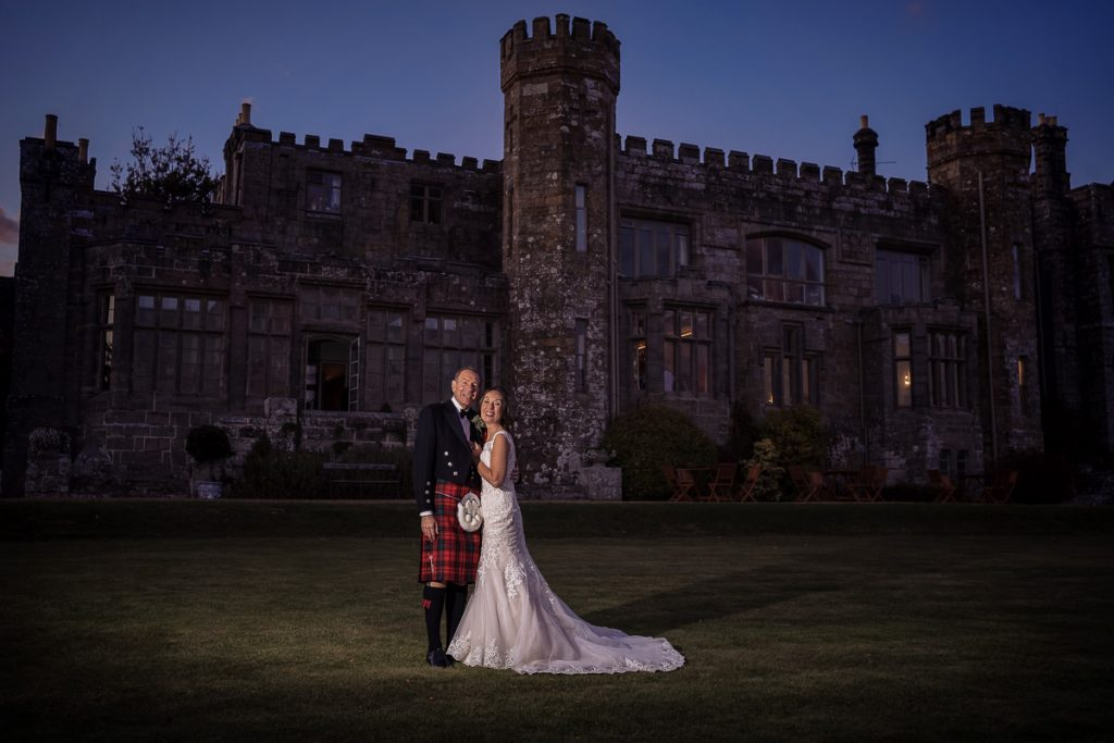 husband in kilt and bride in her glorious white dress