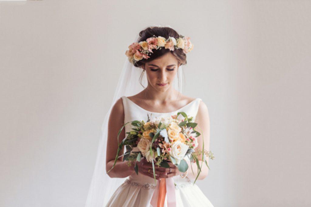 Bride wearing a bouquet of flowers