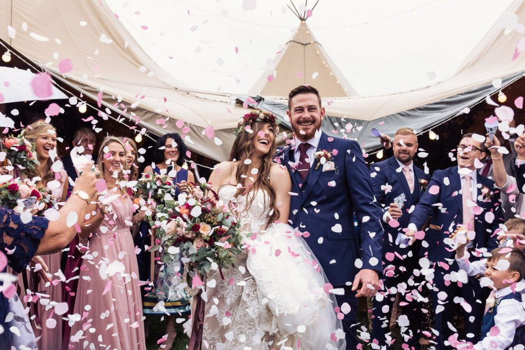 confetti being thrown after the vows