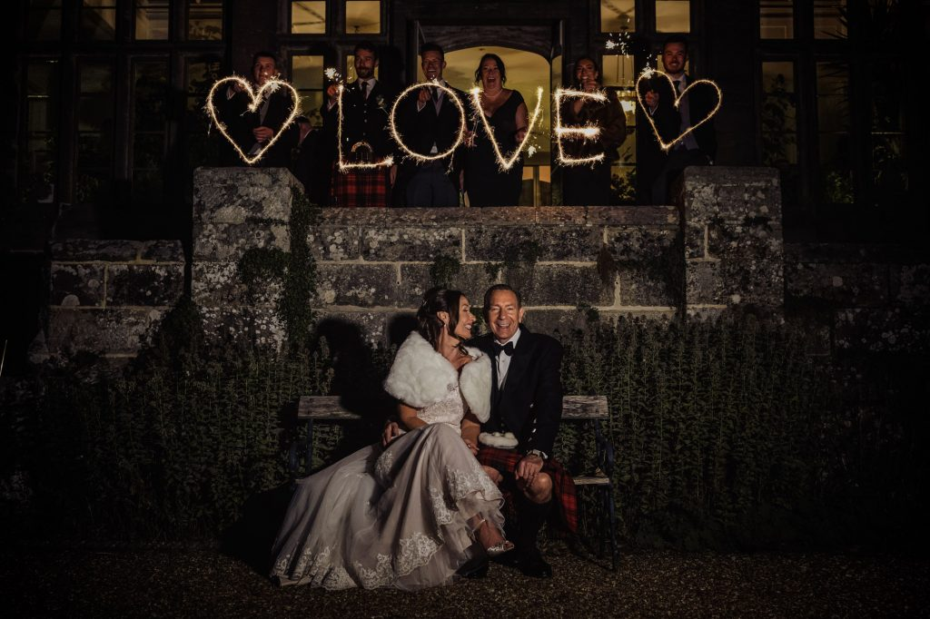 Outdoor wedding photo at night in Wadhurst Castle