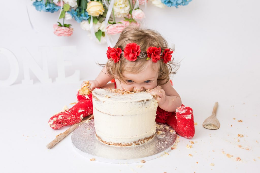 1st birthday girl eating the whole cake without cutting a slice